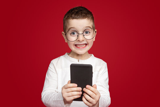 Excited little kid with mobile phone