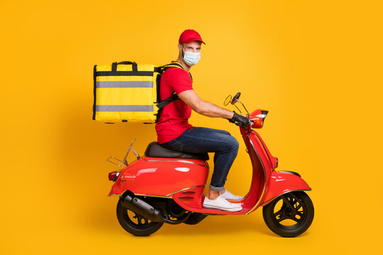 Profile photo of delivery man ride scooter wear bag gloves mask red t-shirt cap jeans sneakers isolated yellow color background