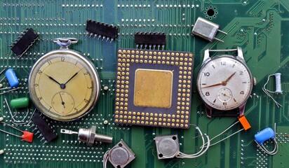 Fototapeta clocks and electronic components mounted on a board obraz