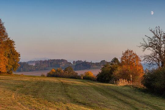 Beautiful hilly autumn landscape. Autumn leaves in forest. Czech republic