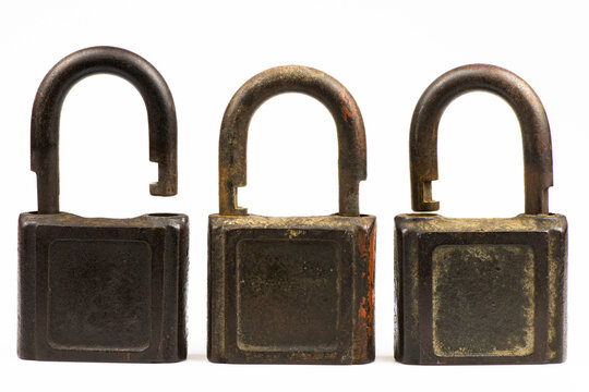 Three old locks by close up isolated on a white background.
