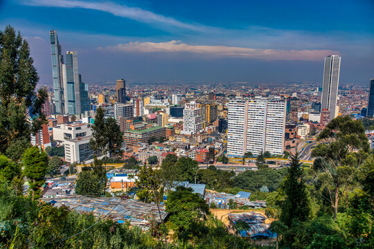 BOGOTA,COLOMBIA/MARCH 15,2018:Panoramic view of the city of Bogota. In the foreground are slum roofs.
