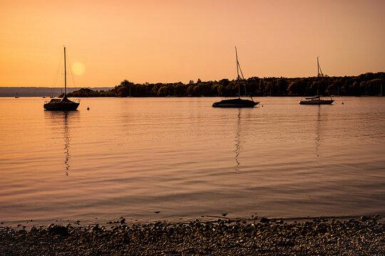 Evening mood with sailing boats at the lake at sunset.