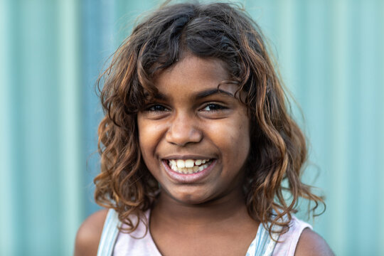 happy smiling 8 year old girl looking at camera