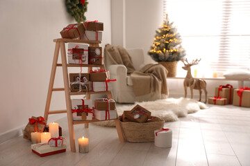 Advent calendar with gifts in room decorated for Christmas. Space for text