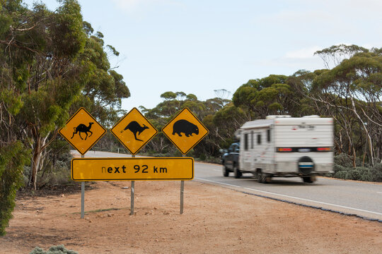 Caravan driving across the nullarbor past road signage