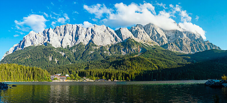 GARMISCH-PARTENKIRCHEN, GERMANY – September 03 2020: Panoramic view of Eibsee and Zugspitze in Germany / Bavaria.