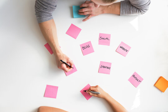 Planning a marketing strategy from above on sticky notes