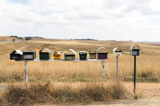 row of mailboxes on a rural road