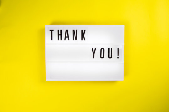 Thank You! text on lightbox on yellow background isolated. Top view, flat lay, thanks of heroes, thanking doctors, nurses and medical staff working in hospitals during COVID-19 coronavirus pandemic