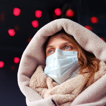 Young woman in face mask in winter outdoor in the new year
