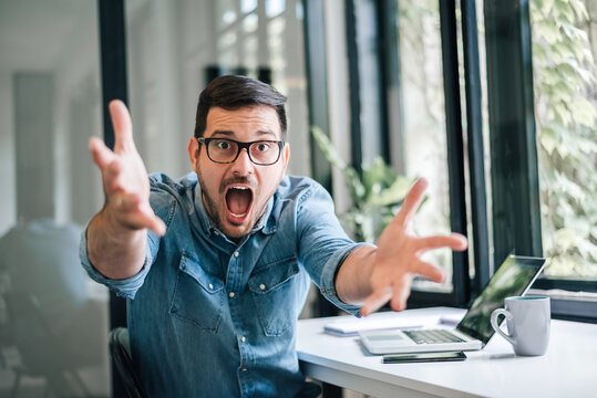 Why! WTF are you doing! Surprised businessman entrepreneur freelancer reacting to not expecting news bad not expected surprise situation suddenly lost information emotional reaction real feelings