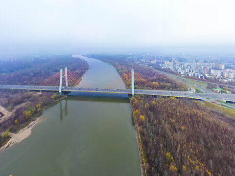 Aerial drone view. bridge  in the rays of a sunny morning. Autumn haze in the air, cars are driving across the bridge.