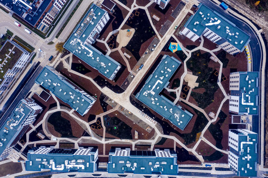 Urban texture and pattern. Aerial view of the city buildings under a cloudy sky.