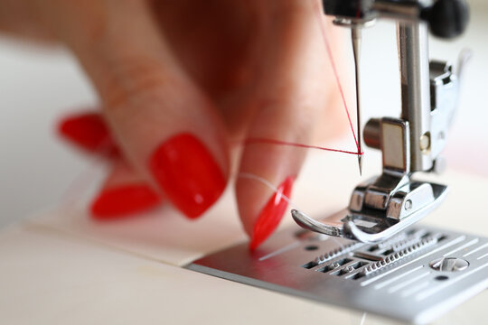 Dressmaker with pretty nails