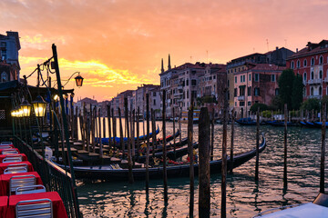 The Grand Canal at sunset with gondola docked along the canal