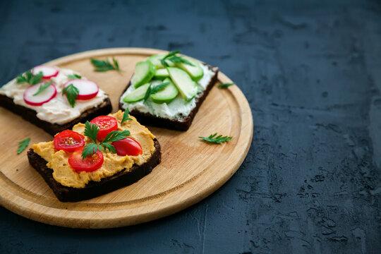 Healthy vegetarian rye bread open sandwiches