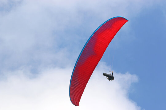 Paraglider flying wing in a blue sky