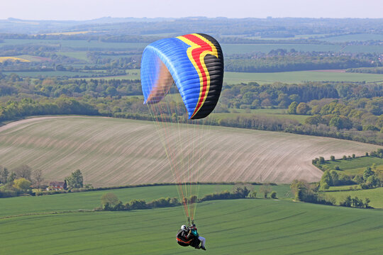 Tandem Paraglider flying at Combe Gibbet, England