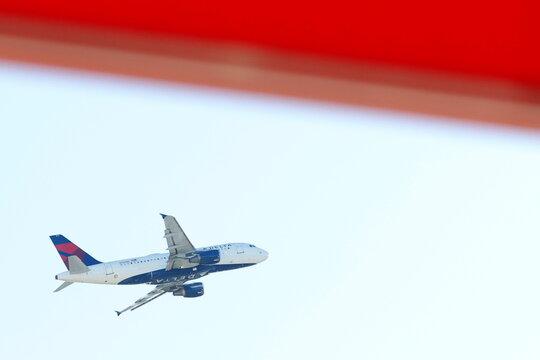 An airplane flies over Hartsfield–Jackson Atlanta International Airport in Atlanta