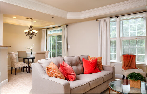 Contemporary home interior with neutral color palette with bright colored accent pillows