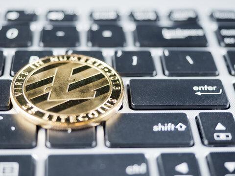 Close-up Of Bitcoin On Computer Keyboard