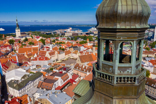 Amazing aerial drone shot of old town of Tallinn, Estonia at sunset
