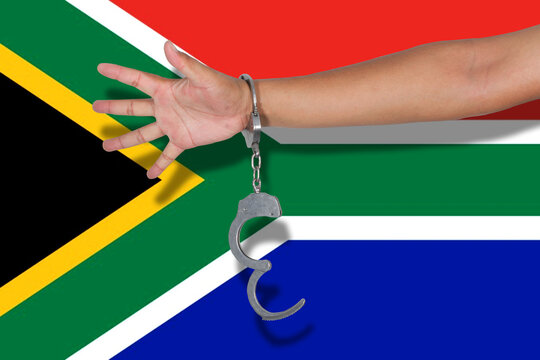 Cropped Hand Of Person Wearing Handcuffs Against South Africa Flag