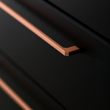 Close-up on copper drawer handle