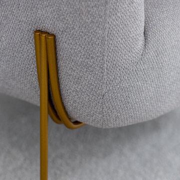 Close-up on golden armchair leg