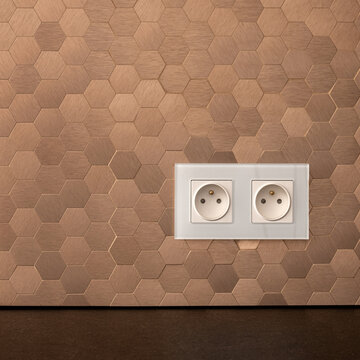 White sockets in copper wall, close-up