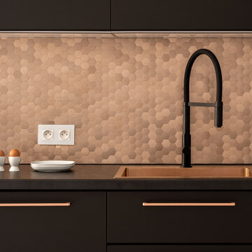 Black and copper kitchen, close-up