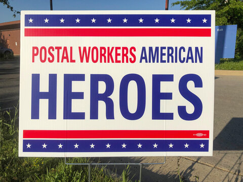 Mclean, Va, USA - May, 15, 2020L Postal Workers American Heroes Poster sign, close up view.