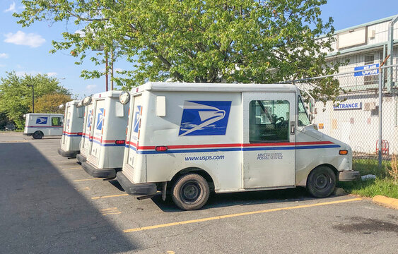 Mclean, Va, USA - May, 15, 2020 USPS car trucks on the parking lot. Postal Workers American Heroes concept.