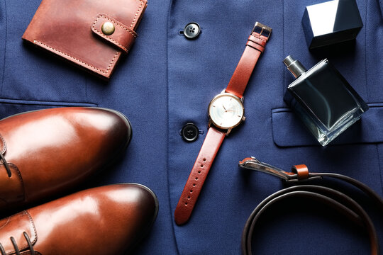 Flat lay composition with luxury wrist watch on blue shirt