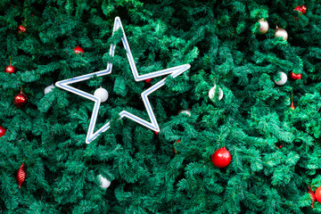 Wall Mural - Christmas tree and ball background, closeup nature view of green leaf