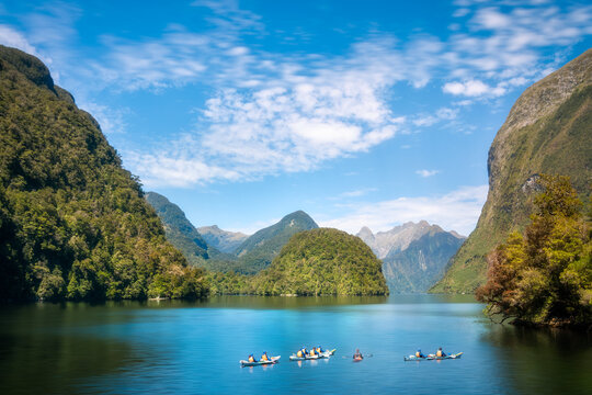 Kayaking into the incredible natural scenery and pristine waters of the fjord is an amazing experience at Deep Cove in Doubtful Sound, New Zealand, South Island.
