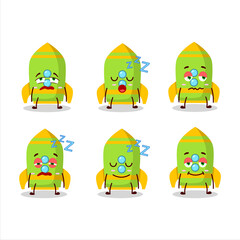 Cartoon character of green rocket firecracker with sleepy expression