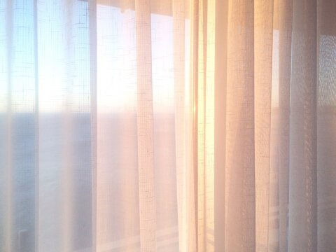 Close-up Of White Curtains On Window
