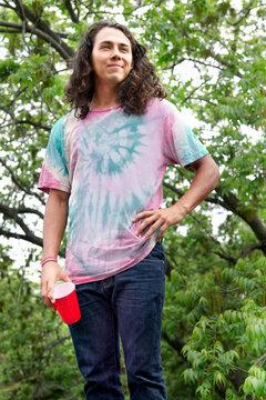 Hispanic man drinking outdoors