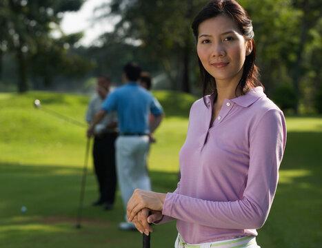 Chinese woman playing golf