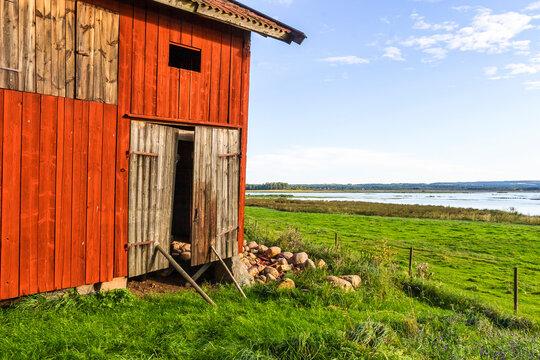 Old wooden barn at a lake