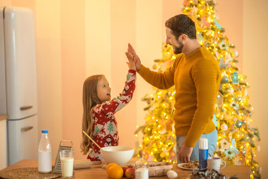 Girl and her dad feeling good and doing high five