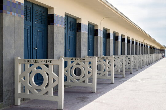 Deauville, France, July 10, 2019. The row of famous beach cabins with celebrity names on promenade des Planches on the seaside.