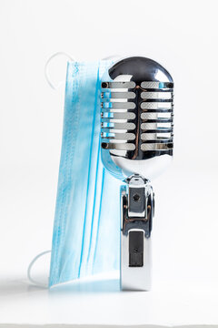 Covid-19 restriction in artist business. Blue mask and silver microphone