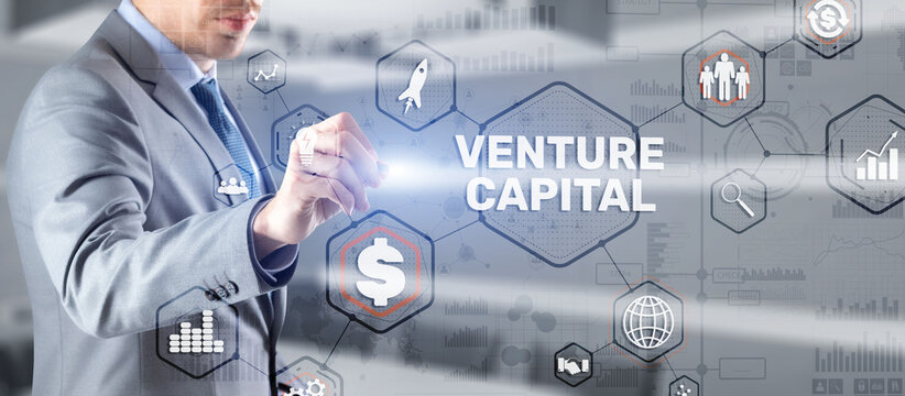 Businessman touching finger Venture Capital. Mixed Media.