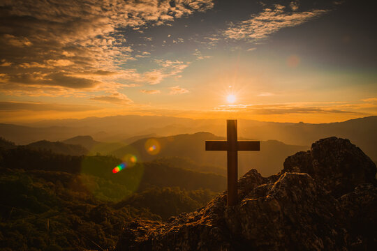 The Crucifixion of Jesus Christ at Sunrise - Three Crosses On Hill. Religious Concepts
