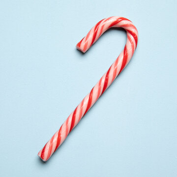 Christmas candy cane on light blue background