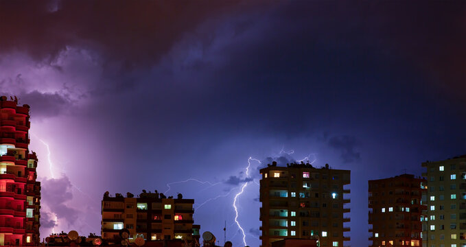 Lightning thunderstorm over the city at night sky