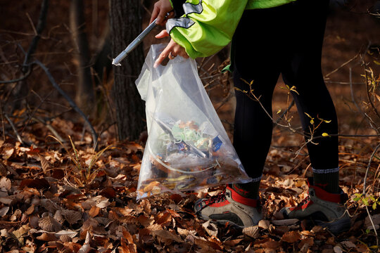 A member of Clean Hikers collects litter while hiking a mountain in Incheon, South Korea